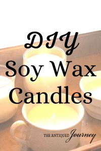 homemade soy wax candles on a galvanized tray
