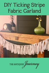 DIY ticking stripe fabric garland displayed on a mantel