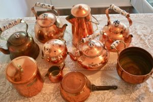 above view of vintage copper collection on table