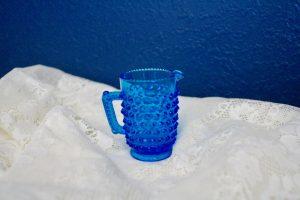 blue glass hobnail pitcher