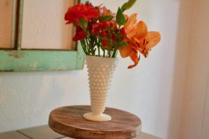 white hobnail vase with flower boquet