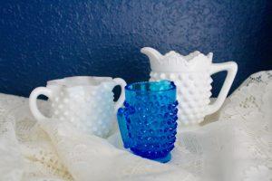 hobnail glass jars on a lace cloth