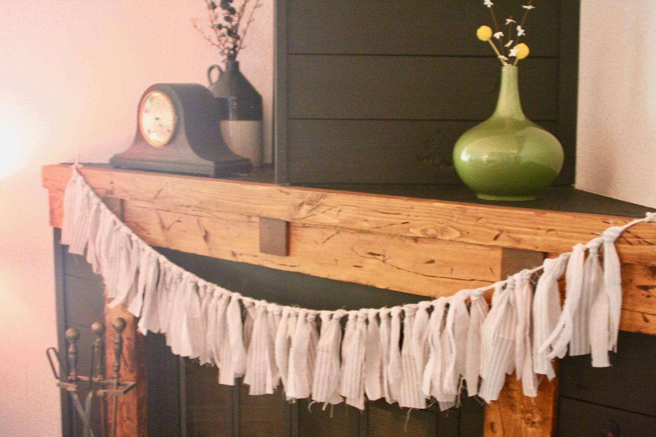 ticking strip fabric garland draped across a mantel
