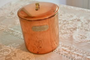 a copper jar with a lid with the word flour on it