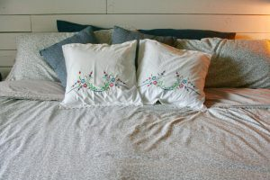 vintage floral throw pillow on bed