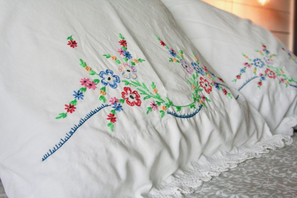 vintage floral throw pillows on the bed