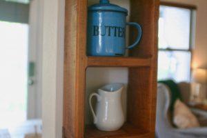 vintage kitchen decor on a wooden peg shelf