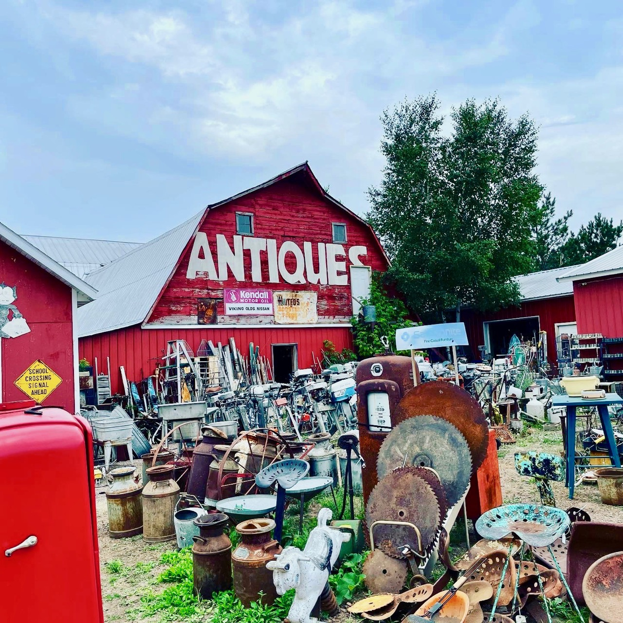 a red barn full of antiques