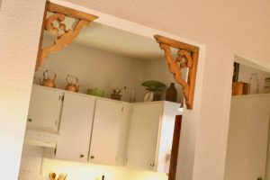 wooden corbels in doorway of kitchen