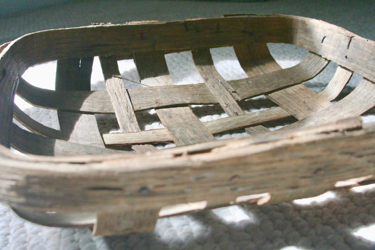 worn wooden antique tobacco basket