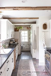 pine and prospect home barn beams on kitchen ceiling