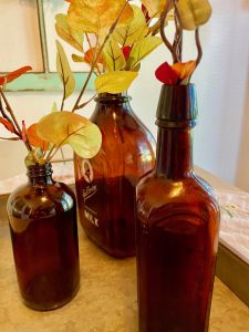 vintage amber colored bottles with faux fall stems
