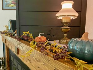 fall mantel decor with faux garland and pumpkins