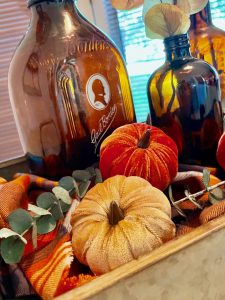 a vintage fall centerpiece with amber bottles