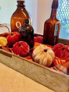amber colored bottles with faux pumpkins