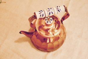 vintage copper teapot with ridges