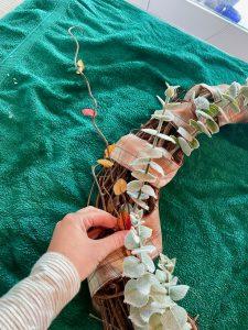 insert fall stems into grapevine wreath