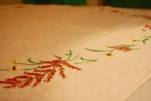 a vintage embroidered fall table linen