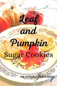 leaf and pumpkin sugar cookies on a vintage plate